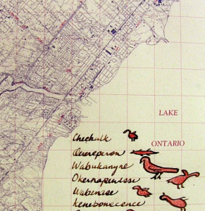 A section of Bonnie Devine's artwork, called 'Titled/Untitled'. The artwork depicts a modern map of Toronto, overlaid with local indigenous language and iconography.