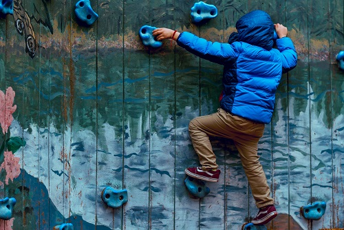 Child on a climbing wall