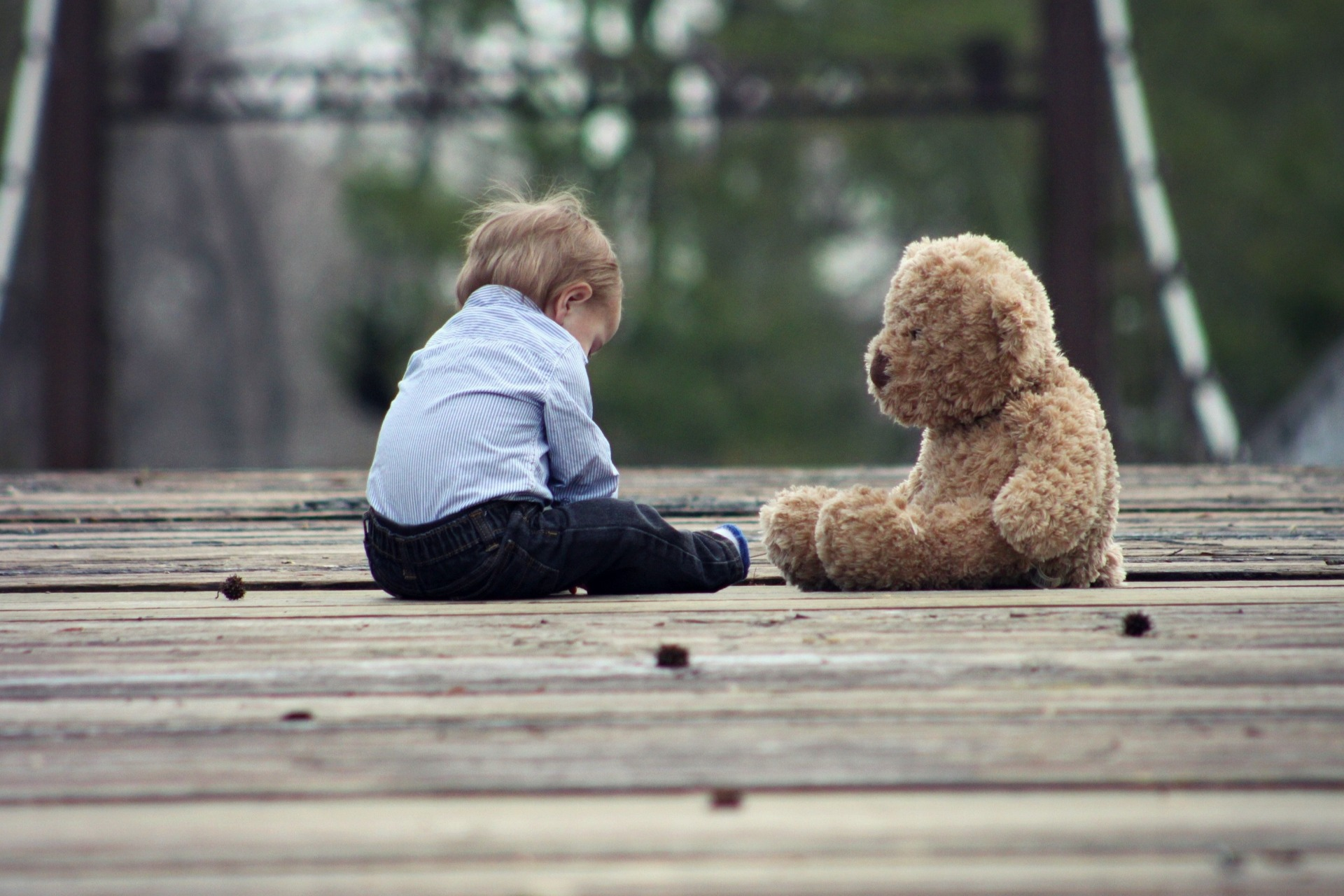 Child with a teddy