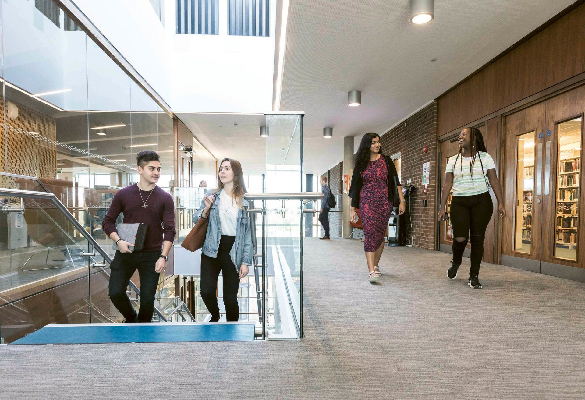 Students walking up stairs inside Templeman Library