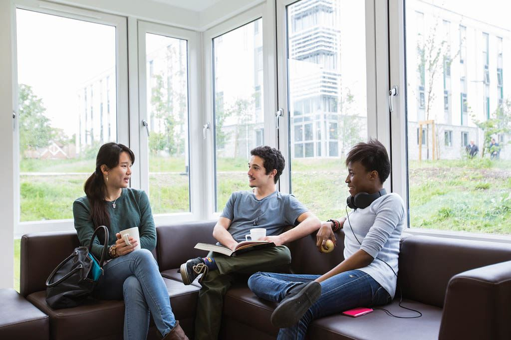 Students sitting on a sofa and talking